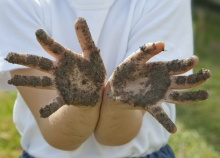 children's hands dirty from the soil .